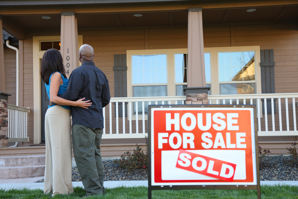 couple buying a house